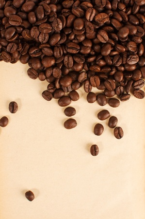coffee grains: Heap of coffee grains over a yellow paper Stock Photo