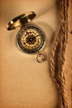 Vintage compass top shot overa grungy yellow paper