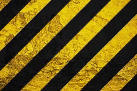 Black and yellow  under construction  sign over a grunge texture Stock Photo - 13642972