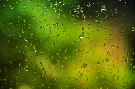 refraction of light: abstract  background showing a window with raindrops rolling off