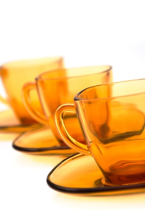 yelllow: yelllow glass tea cups against the white background Stock Photo