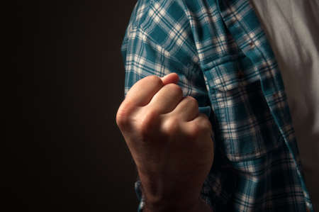 Casual man standing with hist fists clenched in victory, close up  Determination and strength concept  Stock Photo - 13874700