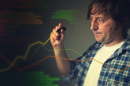 Casual man drawing a rising multicolor chart photo