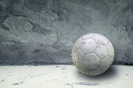 concrete room: Soccer ball in an obsolete gray grunge concrete room