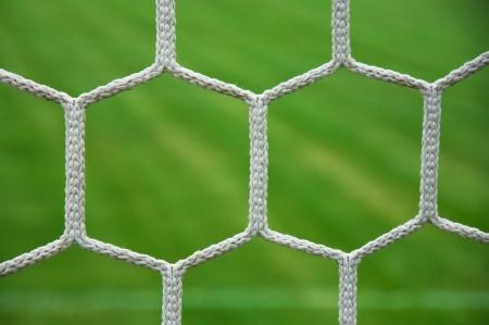 soccer net: Close up detail of a soccer net against green grass