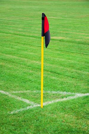 Red and black soccer corner kick flag photo