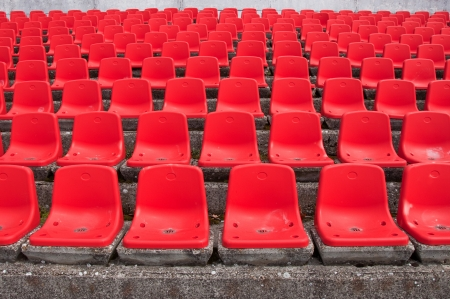 Empty plastic seats at stadium, open door sports arena  photo