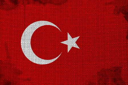 Flag of Turkey overlaying a detailed fabric texture photo