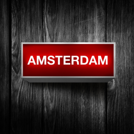 light display: Amsterdam vintage electric red light display with over a dark grunge background  Stock Photo