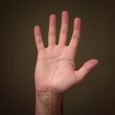Male palm hand gesture against a grungy background,  high five  concept Stock Photo - 14495125