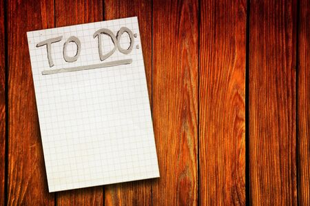 numers: Things To Do, handwritten reminder paper note over a wooden background