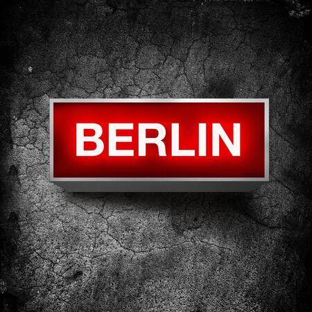 light display: Berlin vintage electric red light display over a dark, grunge background.