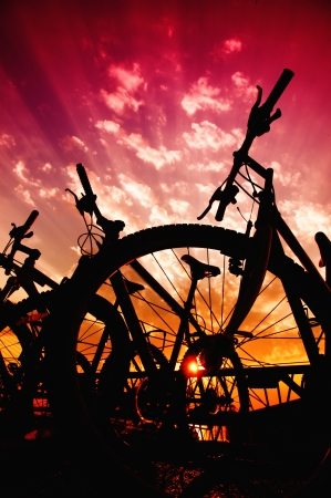bicycle silhouette: Silhouettes of bicycles against the beautiful purple sunset sky