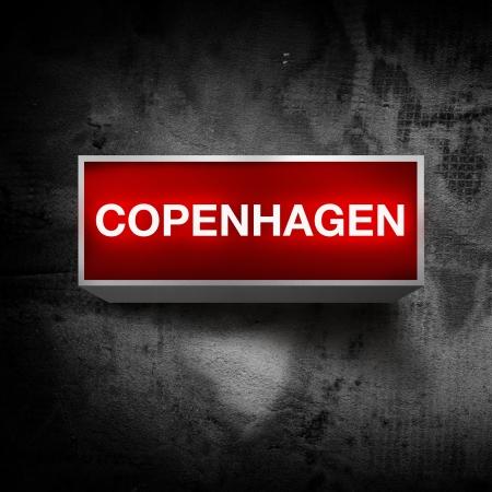 light display: Copenhagen vintage electric red light display over a dark, grunge background. Stock Photo