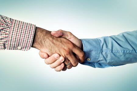 ritual: Two businessmen shaking hands, common greeting ritual Stock Photo