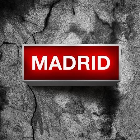light display: Madrid Vintage electric red light display over a dark, grunge background.
