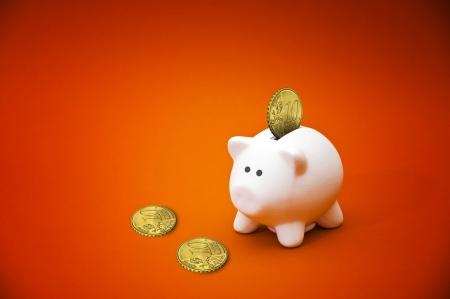 Beatiful white ceramic piggy coin bank, money savings concept Stock Photo