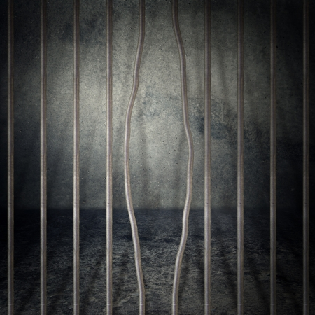 Obsolete gray grunge concrete room, prison cell with metal bars. Stock Photo - 14792266