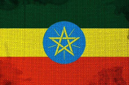 overlaying: Grungy Ethiopian Flag overlaying a fabric texture Stock Photo