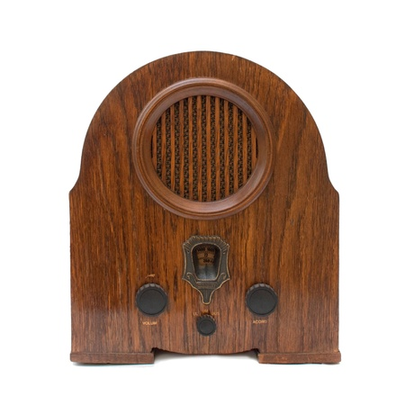 Vintage radio device over a white background photo