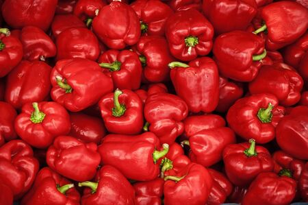 pile of fresh red paprika, agriculture background image for organic food production photo