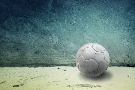 Soccer ball in an obsolete gray grunge concrete room Stock Photo - 15220617