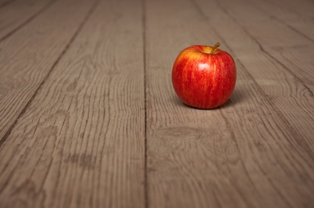 Tasty red apple on table; agriculture background image - organic food production photo