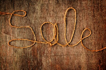sellout: Word Sale written with an old twine rope.