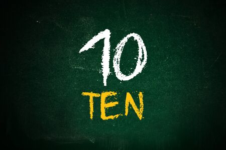 number 10: Number ten, handwritten number ten with a chalk on a green chalkboard.
