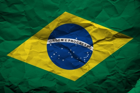 overlaying: Grunge flag of Brasil, illustration is overlaying a grungy texture