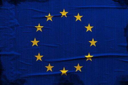 Grunge blue Europian Union flag with yellow stars overlaying a grungy texture photo