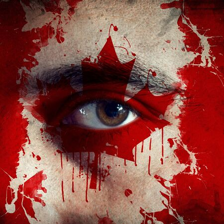 flag painted on face of a national team supporter, close up of a male eye. photo