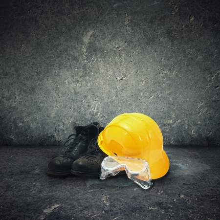 industrial background: Protective equipment in obsolete gray grunge concrete room