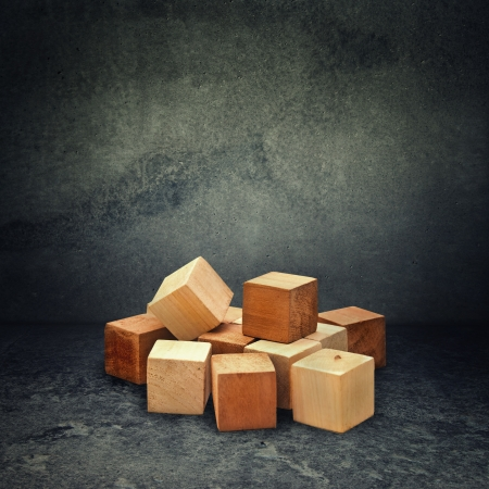 Wooden brick puzzle in obsolete gray grunge concrete room Stock Photo - 15694483