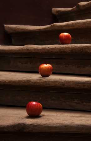 applet: Tasty red apples on stairs; agriculture background image - organic food production Stock Photo