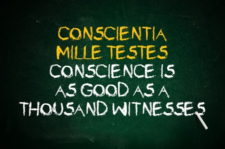 conscience: Conscience is as good as a thousand witnesses. Latin quote handwritten with chalk on a green school board.