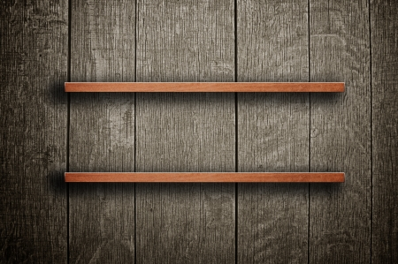 wall bars: Vintage wooden bookshelf over a grungy background Stock Photo