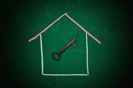 Drawing of a house and a vintage key on a green chalkboard Stock Photo - 16221061