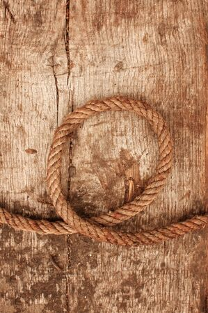 Ship rope and weathered wood background photo