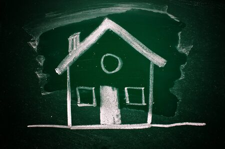 Drawing of a house on a green chalkboard Stock Photo - 16557522