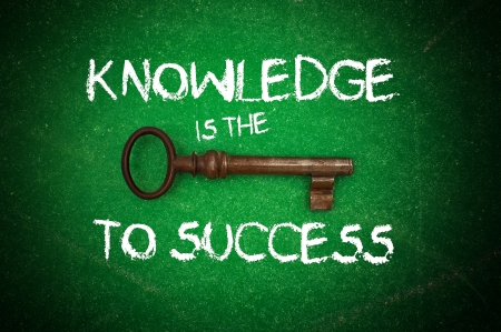 Knowledge is the key to success written on a green chalkboard photo