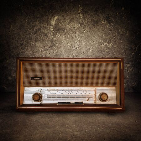 Beautiful old vintage wooden radio receiver device photo