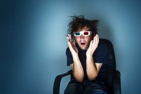 scared man with 3d anaglyph glasses in cinema chair Stock Photo - 16694548