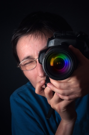 photography session: Portrait of female photographer  with a dslr camera.