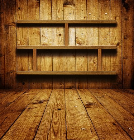 shelving: Vintage wooden bookshelf over a grungy background Stock Photo