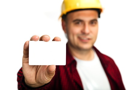 holding business card: Construction worker holding a blank business card, business introduction concept.