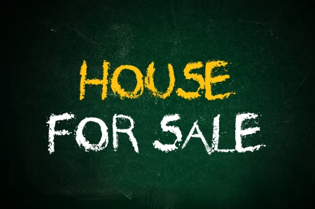 Drawing of a house on a green chalkboard Stock Photo - 16916648