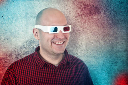Portrait of a smiling man with anaglyph glasses enjoying a 3d movie. Stock Photo - 16898844