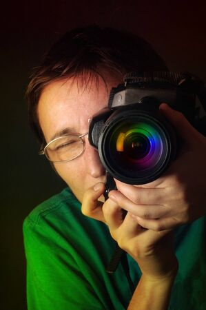 studio photography: Portrait of female photographer taking a photo with a dslr camera  Stock Photo