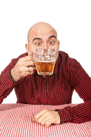Young adult bald man drinks beer from a jug Stock Photo - 17079496